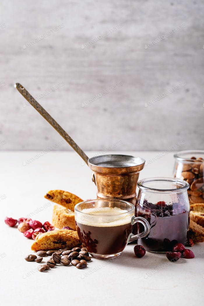 Cup of espresso coffee with cranberry cantucci