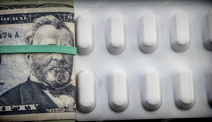 Dollar bills along with white pill package, conceptual image co-payment health