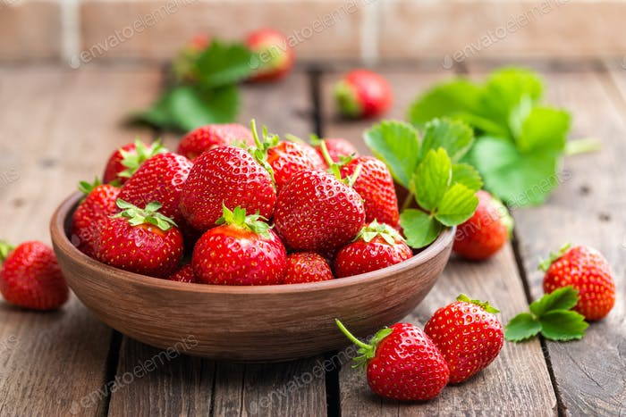 Fresh juicy strawberries with leaves. Strawberry.