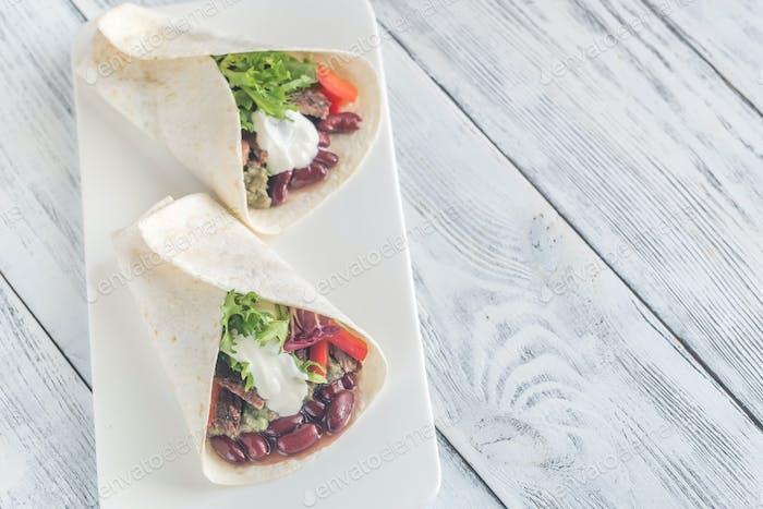 Burritos on the white plate