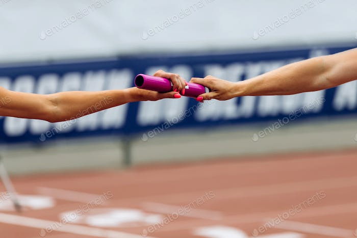 relay race racing hands women runners