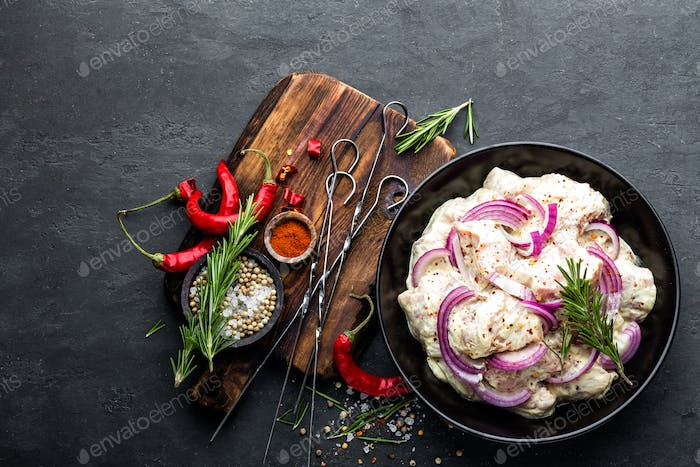 Shashlik marinated for grill in onion, chili peppers and spices