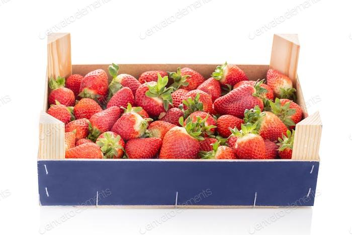 Fresh strawberries in wooden crate