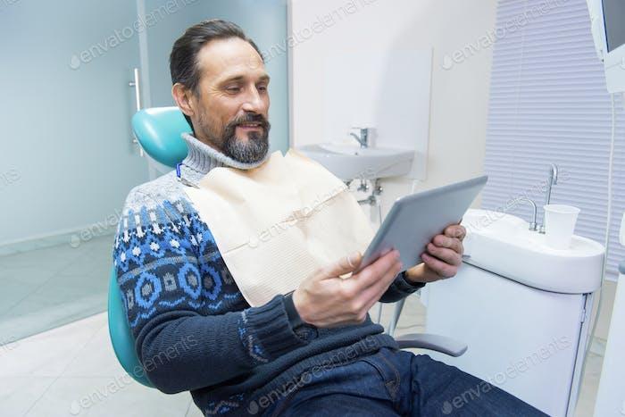 Man sitting in dentist chair
