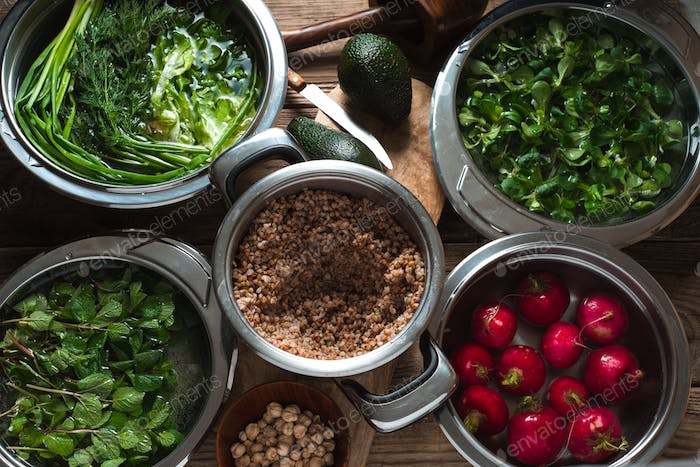 Ingredients for healthy salad with buckwheat ,vegetable and greens top view