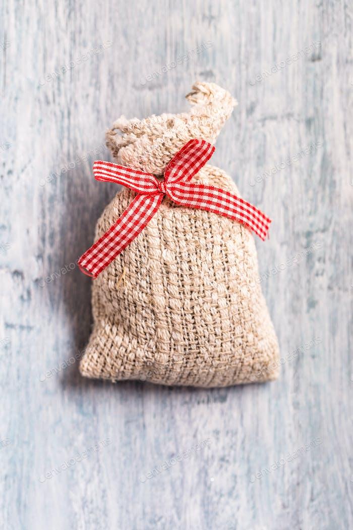 Gift bag on light blue background