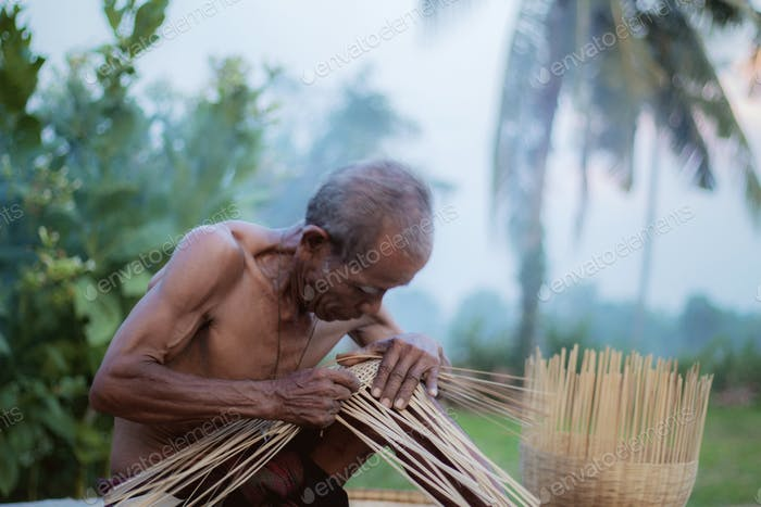 Old man are weaving in countryside
