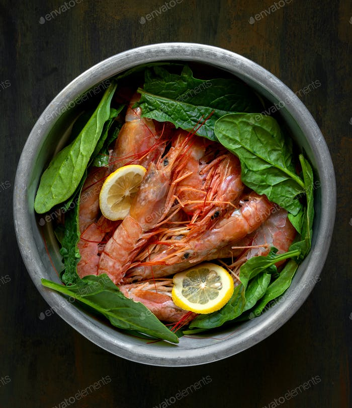 raw fresh shrimps and spinach wood
