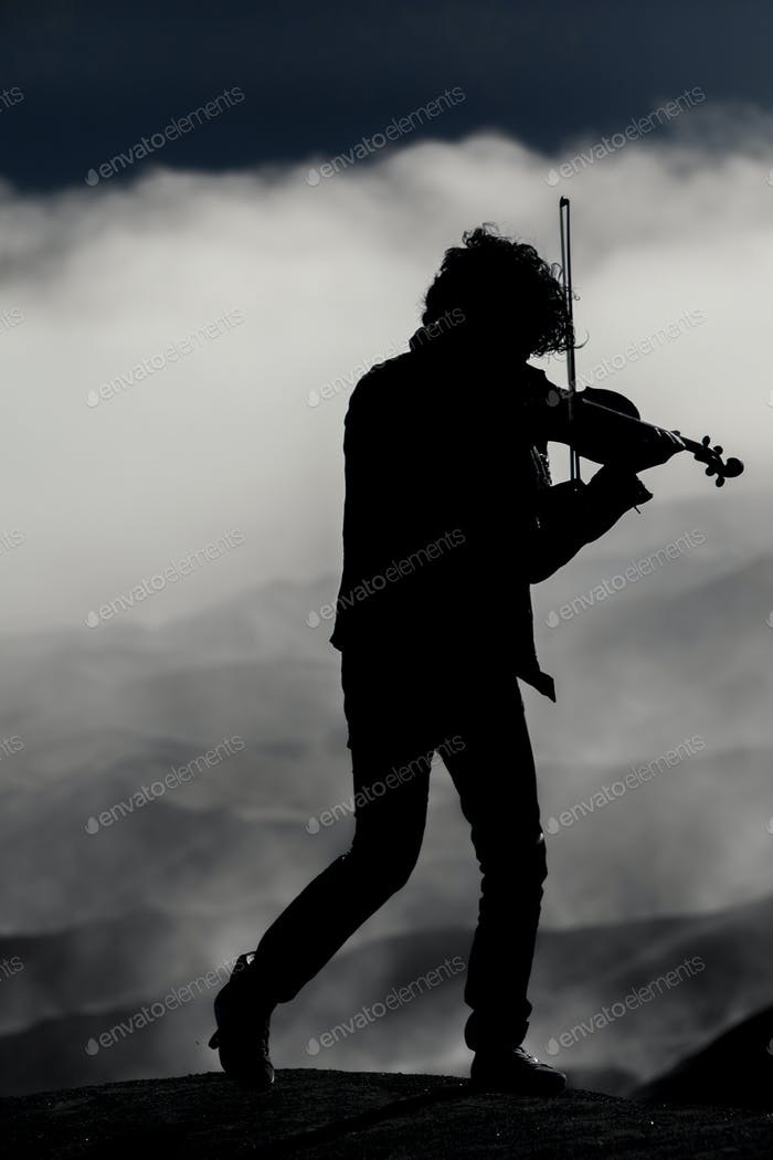 violinist silhouette on the volcano