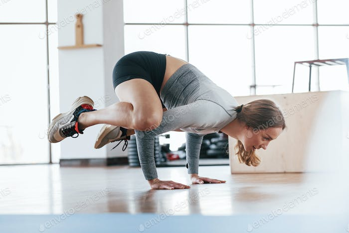 Sportive young woman have fitness day in the gym at morning time