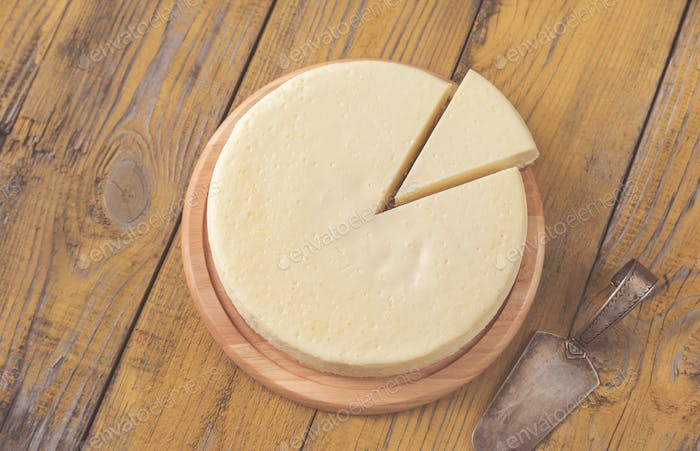 Traditional cheesecake on the wooden table