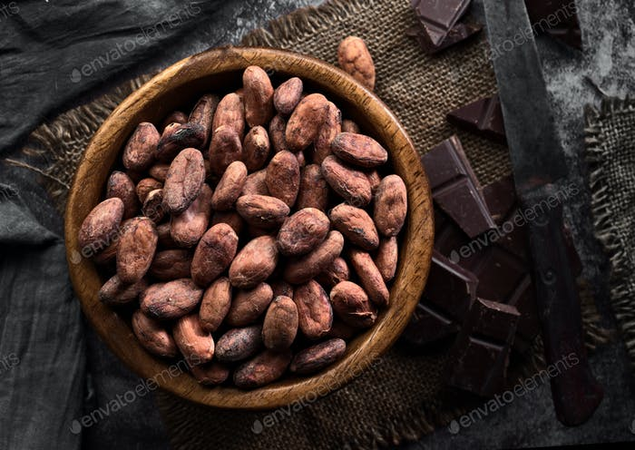 wooden bowl filled with cocoa seeds