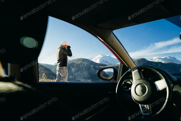 tourist male travel by car in mountains