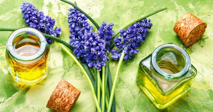 Oil and lavender flowers