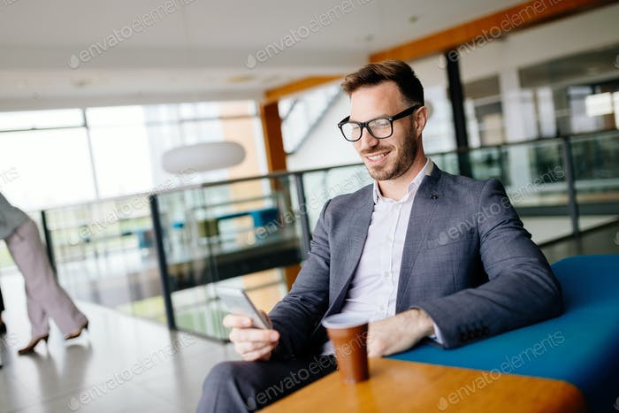 Businessman taking a break with a cup of coffee in office