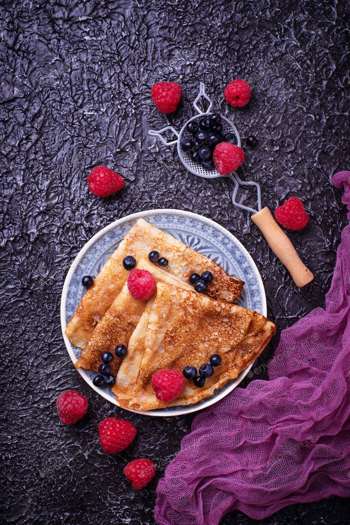 Pancakes with blueberries and raspberries