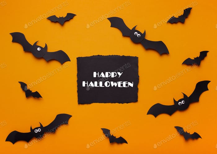 Happy Halloween concept with flying bats and text