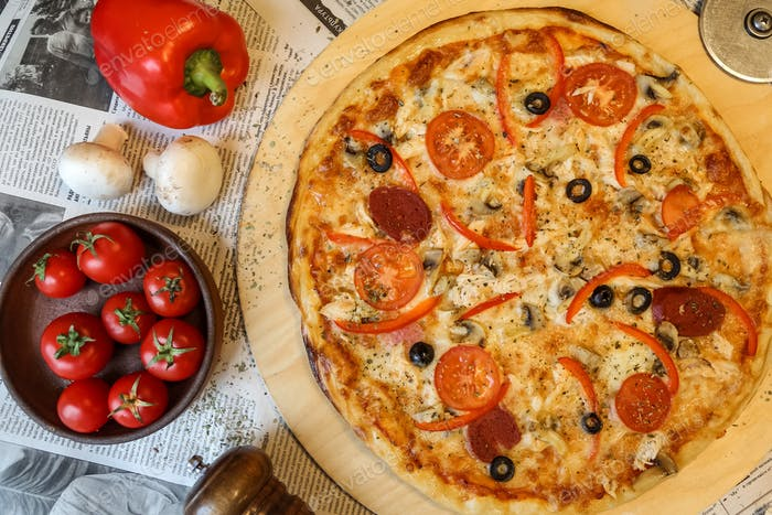 top view salami pizza on a tray with mushrooms and tomatoes with bulgarian red pepper