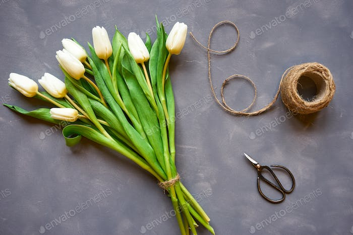 Bouquet of white tulips and accessories