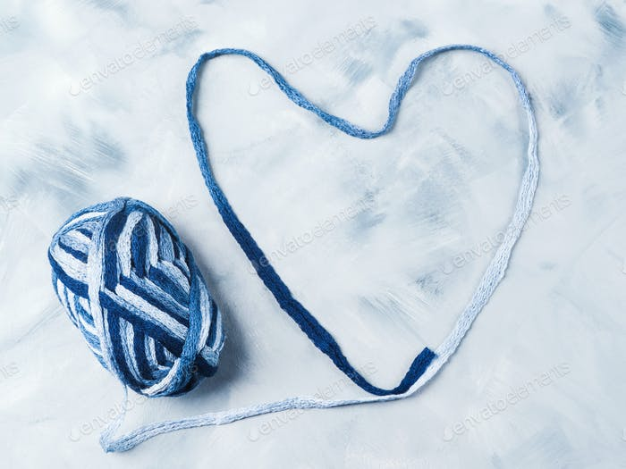 Blue cotton knitting yarn in heart shape