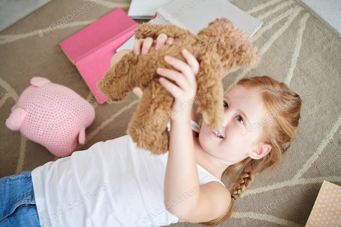 Playing with teddy bear