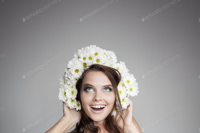 Surprised Smiling Woman With Flower Wreath Looking Up