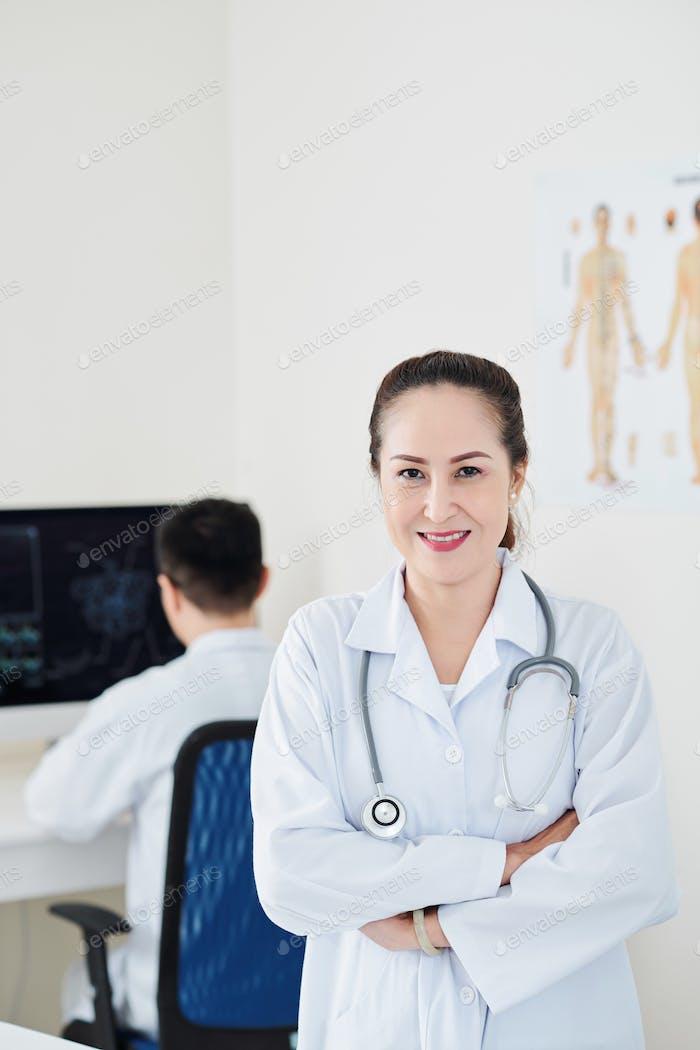 Pretty Asian mature doctor