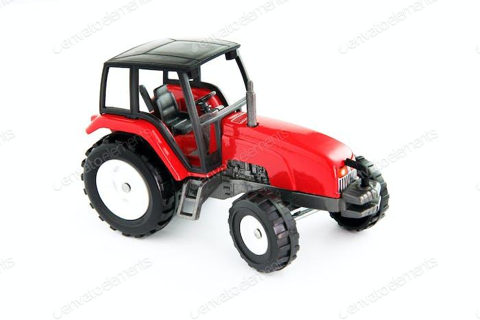 Roter Spielzeug-Traktor