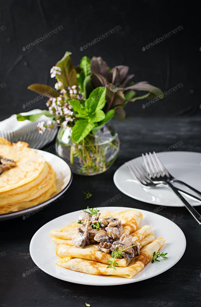 Pancakes with mushrooms.  Homemade baking. Maslenitsa week. Maslenitsa.