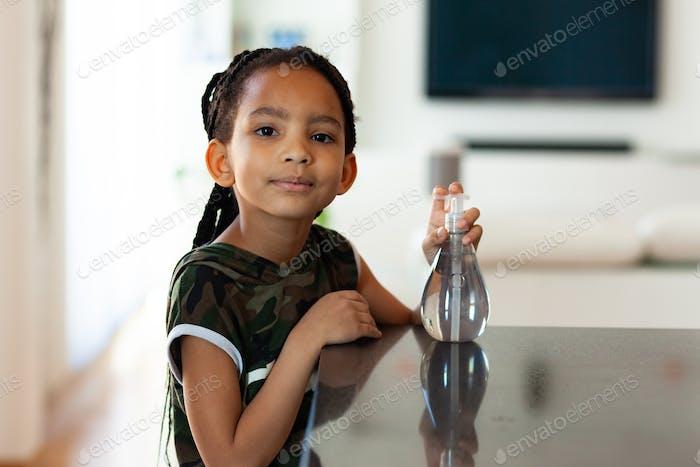 Black African American children using antibacterial antiseptic hand sanitizer gel