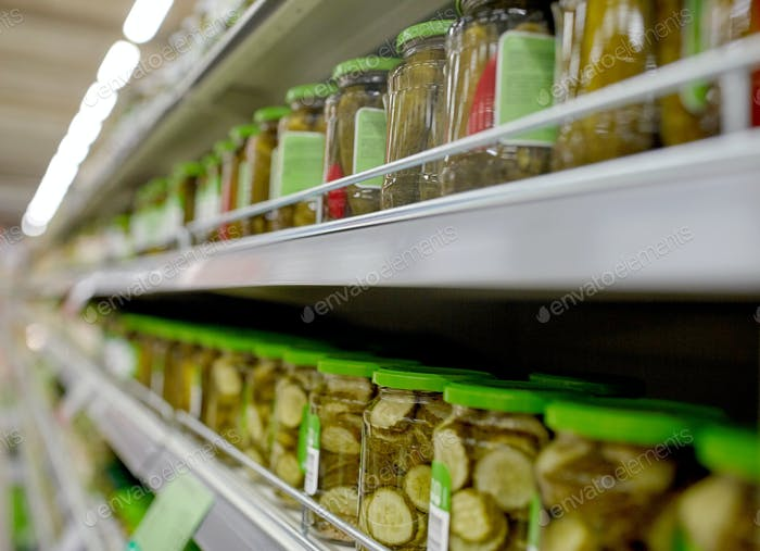 jars of pickles on grocery or supermarket shelves