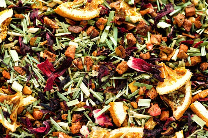 Mix tea karkade with dried fruits and flowers. Fruit tea background and texture. Top view. Food