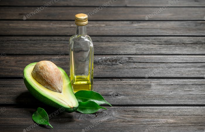 Oil and avocado with foliage.