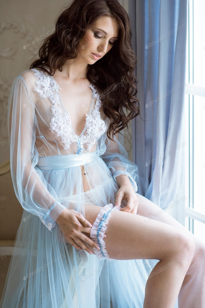 Beautiful sexy lady in elegant blue robe