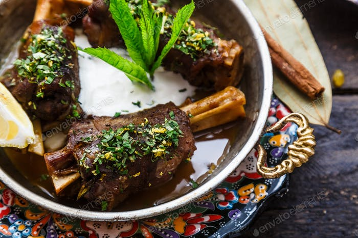 Lamb shanks in coper pan, close view