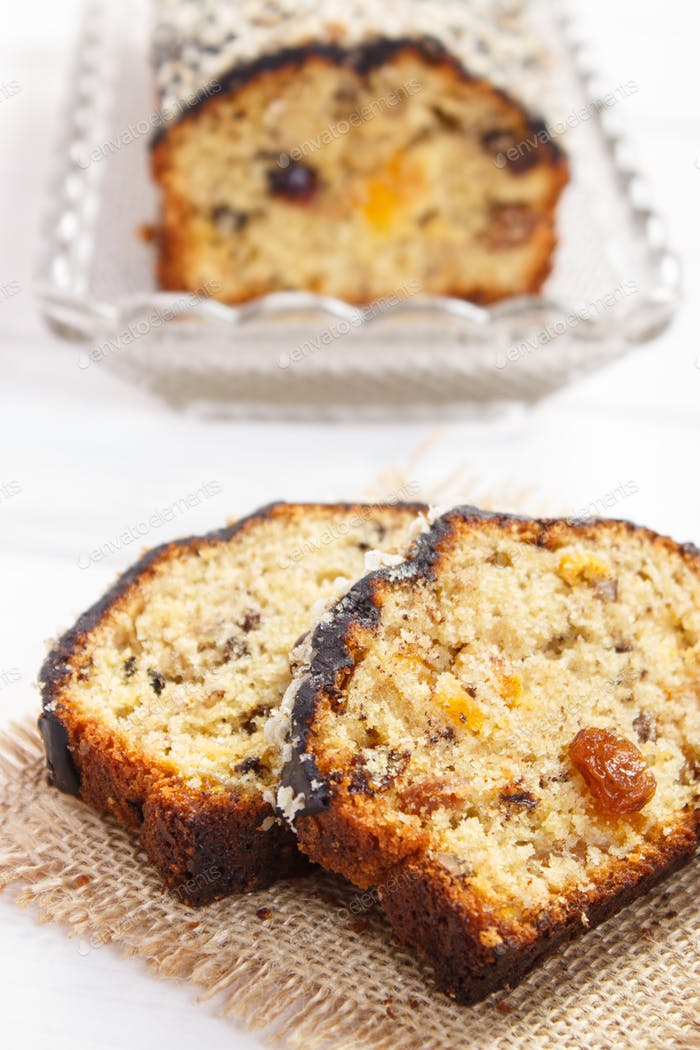 Fresh baked fruitcake on boards
