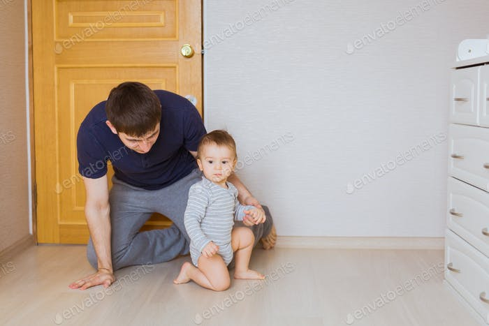 father's day concept - Happy family father and baby child son indoors