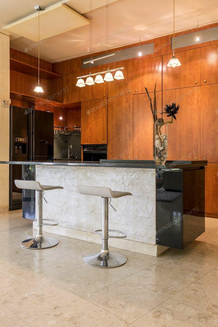 Stone kitchen island with stools