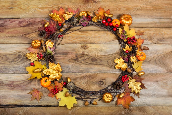 Thanksgiving door wreath with pumpkins and pine cones