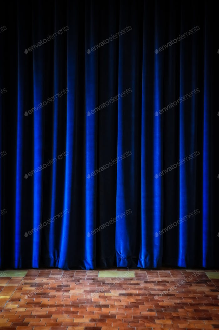 Colorful blue stage curtains and tiled floor