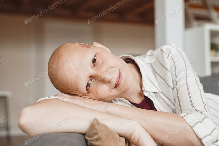 Adult Bald Woman Smiling at Camera