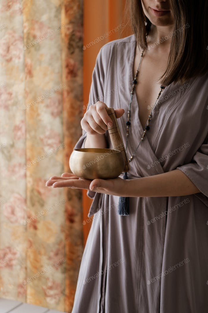 Woman holding in hands singing bowl