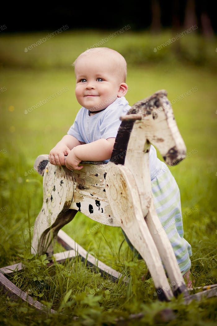 Little boy on rocking horse