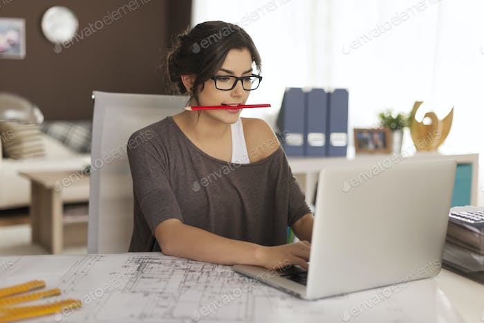 Very busy young architect working at home