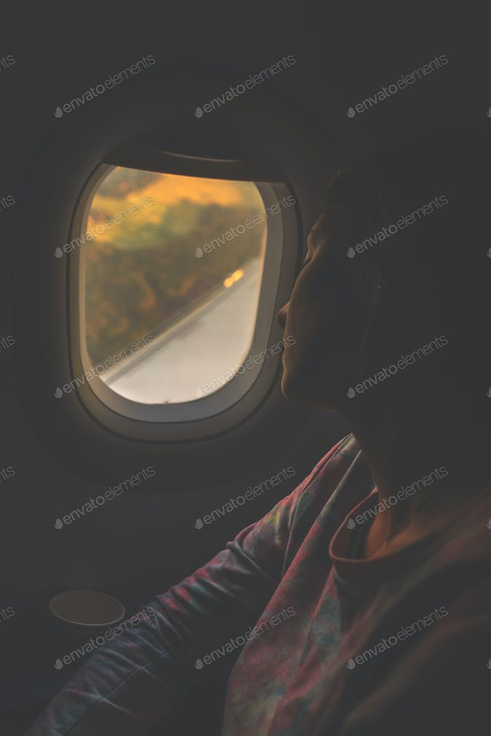young beautiful woman sleeping in the passenger seat airliner.