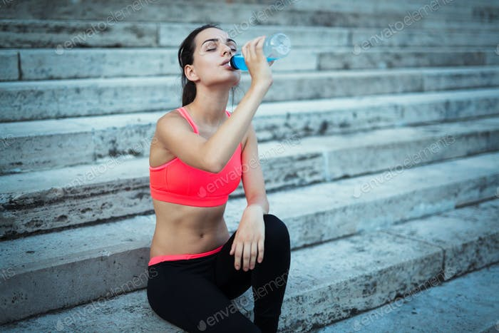 Thirsty sportswoman doing her jogging training