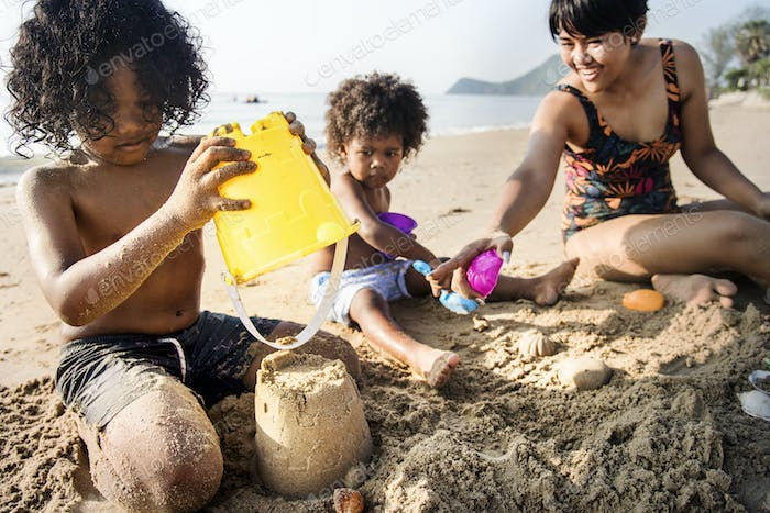 A family building sandcastles
