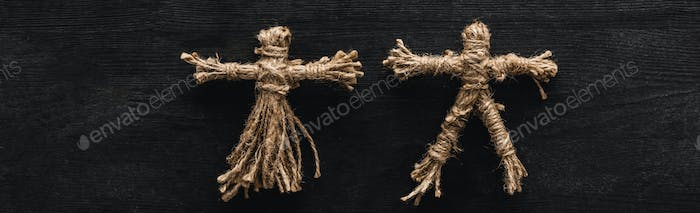 Panoramic Shot of Creepy Voodoo Dolls on Black