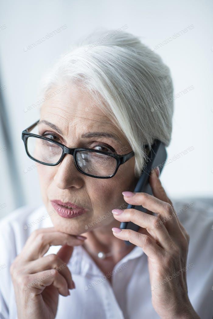 Senior business woman talking on phone