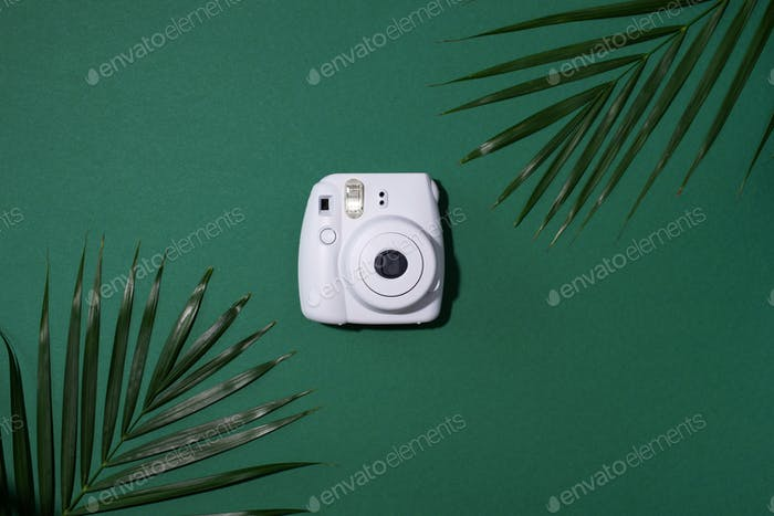 Vilnius, Lithuania - September 16, 2019: FUJIFILM INSTAX Mini Instant Film Camera on green
